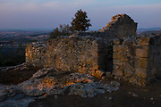 Santa Maria dels Albats - ancient church that is part of the Olerdola complex of ancient sites, near Vilafranca del Penedes, Catalonia. This church dates to around the 10th century, and is surrounded by graves cut into the rock.