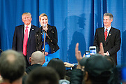 A pregnant Ivanka Trump introduces her father, the republican Presidential candidate Donald Trump (left) to supporters in an overcrowd room at a campaign event in Milford, NH. To the left of her is former Senator Scott Brown. Scott Brown was at the event to endorse Donald Trump.