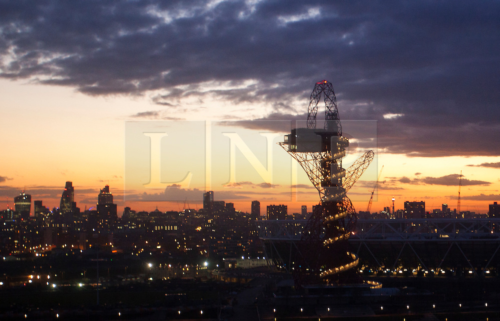 © Licensed to London News Pictures . 01/03/2014. London, UK.  A sunset view of the ArcelorMittal Orbit seen from Stratford. The tower will be open for visitors from 5 April this year (05/04/2014) Photo credit: Isabel Infantes /LNP