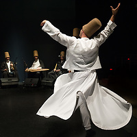 A whirling Dervish of the Galata Mevlevi Ensemble perfoms at Auditorium Candiani '
