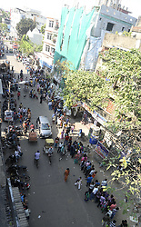 November 13, 2016 - Kolkata, West Bengal, India - Indians queued outside State Bank of India to deposit and exchange demonetized currency notes in Kolkata from early morning.To facilitate smooth exchange and deposit the old Rs. 500 and Rs. 1000 bank note bank across India remain open for public on Sunday , as announced by Union Government after demonetized Rs.500 and Rs.1000 bank notes to tackle the menace of black money. Indian line up outside the banks to deposit and exchange demonetized bank note from late night. (Credit Image: © Saikat Paul/Pacific Press via ZUMA Wire)