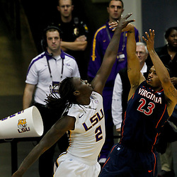 January 2, 2012; Baton Rouge, LA; Virginia Cavaliers forward Mike Scott (23) shoots over LSU Tigers forward Johnny O'Bryant (2) during the second half of a game at the Pete Maravich Assembly Center. Virginia defeated LSU 57-52.  Mandatory Credit: Derick E. Hingle-US PRESSWIRE