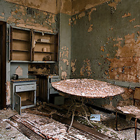 A deserted interior with crumbling walls