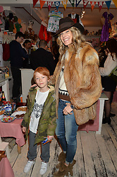 KIM HERSOV and her son AIDAN at a promotional party for the A Girl For All Time doll held at HoneyJam, 2 Blenheim Crescent, London on 5th December 2015.
