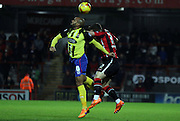 Ashley Chambers and Shaun Beeley battle during the Sky Bet League 2 match between Morecambe and Dagenham and Redbridge at the Globe Arena, Morecambe, England on 1 December 2015. Photo by Pete Burns.