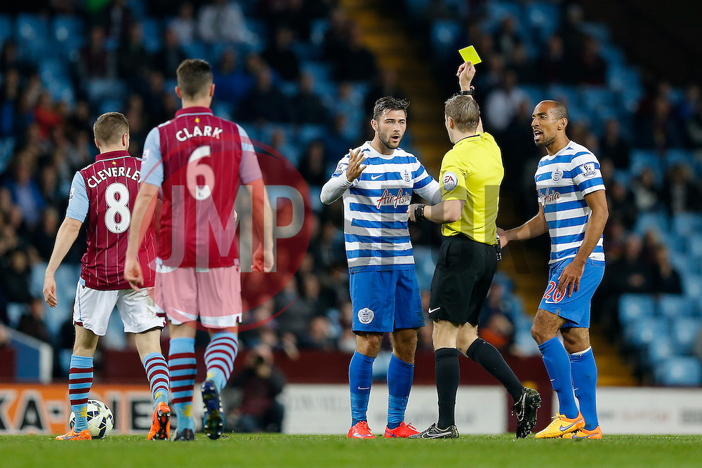 Charlie Austin of QPR is shown a yellow card by referee Craig Pawson - Photo mandatory by-line: Rogan Thomson/JMP - 07966 386802 - 07/04/2015 - SPORT - FOOTBALL - Birmingham, England - Villa Park - Aston Villa v Queens Park Rangers - Barclays Premier League.