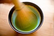 Stirring Matcha, Japanese powdered green tea used in the Tea Ceremony