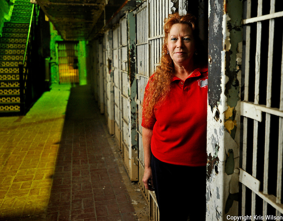 "Marie Lacey, a member of the Jefferson City Paranormal Investigators, poses in one of the cells in what was once the women's facility inside ""The Walls"" of the old Missouri State Penitentiary, a reportedly haunted facility once known as the ""bloodiest 47 acres in America."""