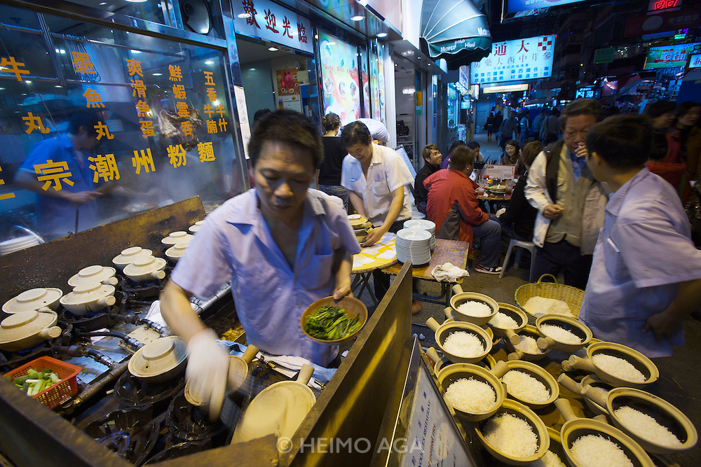 Kowloon. Temple Street Night Market. Open air restaurants. Bowls of freshly cooked rice.