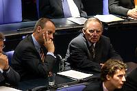 21 OCT 2004, BERLIN/GERMANY:<br /> Friedrich Merz (L), MdB, CDU, Stellv. Fraktionsvorsitzender der CDU/CSU Bundestagsfraktion, und Wolfgang Schaeuble (R), MdB, CDU, ehem. Fraktions- und Parteivorsitzender, in den Reihen der CDU/CSU Fraktion, Bundestagsdebatte, Plenum, Deutscher Bundestag<br /> IMAGE: 20041021-01-050<br /> KEYWORDS: Wolfgang Sch&auml;uble
