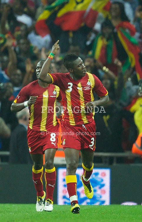 LONDON, ENGLAND - Tuesday, March 29, 2011: Ghana's equalising goal-scorer Asamoah Gyan celebrates in front of the travelling supporters after scoring in injury time against England during the international friendly match at Wembley Stadium. (Photo by David Rawcliffe/Propaganda)
