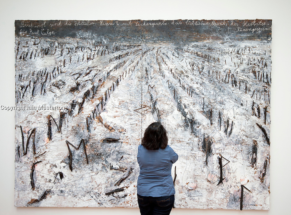 Woman looking at painting The Autumn's Whisper - for Paul Celan by Anselm Kiefer at Gemeentemuseum in The Hague, Den Haag,  Netherlands