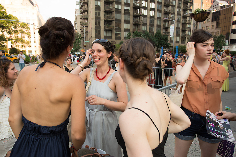 Choreographer Shandoah Goldman talks to two of the dancers after the performance.