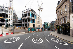 Edinburgh, Scotland, UK. 18 April 2020. Views of empty streets and members of the public outside on another Saturday during the coronavirus lockdown in Edinburgh. Leith Walk deserted at new St James Centre construction site. Iain Masterton/Alamy Live News