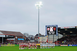 Gloucester and London Irish players stand for a minutes silence in honour of former Gloucester captain Mike Nicholls (recently deceased) before the first half of the match - Photo mandatory by-line: Rogan Thomson/JMP - Tel: Mobile: 07966 386802 05/01/2013 - SPORT - RUGBY - Kingsholm Stadium - Gloucester. Gloucester Rugby v London Irish - Aviva Premiership.