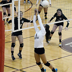 Conestoga's Elizabeth Lawton (6) saves the the ball as Ridley's Erin Scanlan (14) and Carlee Herrin (22) look on during Wednesday nights volleyball match at Conestoga. (Times staff / TOM KELLY IV)