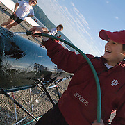 Some of the boats cost as much as $36,000. The crews wash them down with soap and water after each practice.