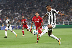 September 27, 2017 - Turin, Italy - Juventus defender Alex Sandro (12) reaches for the ball during the Uefa Champions League group stage football match n.2 JUVENTUS - OLYMPIACOS on 27/09/2017 at the Allianz Stadium in Turin, Italy. (Credit Image: © Matteo Bottanelli/NurPhoto via ZUMA Press)