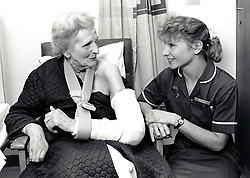 Nurse & elderly woman, City Hospital, Nottingham UK 1991
