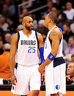 Mar. 08, 2012; Phoenix, AZ, USA;  Dallas Mavericks guard Vince Carter (25) and forward Shawn Marion (0)  react while on the court during a game against the Phoenix Suns at the US Airways Center.  The Suns defeated the Mavericks 96-94. Mandatory Credit: Jennifer Stewart-US PRESSWIRE.
