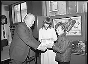1980-03-07.7th March 1980.07/03/1980.03-07-80..Photographed at Maguire & Paterson, Dublin..Michael a Match for any man:..Delivering the Goodies:..Alan Buttanshaw, Managing Director of Maguire & Paterson gives a prize to Glyn O'Scanail (11),  winner of a £15 prize, Ard na Carrig, An Spidéal, Connemara, Co Galway while Ruth Buchanan, presenter of RTE's Poparama looks on admiringly ..