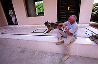 31 August 2005...An anti-explosive shepperd dog with a US Department of Defence's contractor. The dog barks to everyone who goes throught the pictured door on the left.