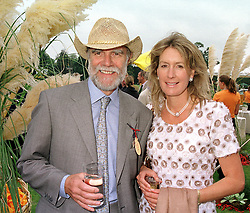 VISCOUNT & VISCOUNTESS COWDRAY at a polo match in Sussex on 23rd July 2000.OGI 128