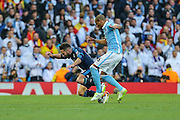Manchester City's Fernando tackles Real Madrid's Daniel Carvajal from behind during the Champions League match between Manchester City and Real Madrid at the Etihad Stadium, Manchester, England on 26 April 2016. Photo by Shane Healey.