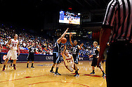 UD junior Samantha MacKay (14) takes a toss to the basket at the buzzer sounds to end the first half as the Rhode Island Rams play the University of Dayton Flyers at UD Arena in Dayton, Saturday, January 7, 2012.