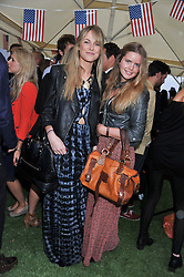 Left to right, LUCIA RUCK KEENE and KATIE READMAN at Inception Group's Hamptons Garden Party to celebrate their collaboration with Embassy Gardens 2016 held at the Ballymore Marketing Suite, Nine Elms Lane, London on 12th July 2012.