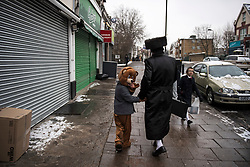 **2018 Pictures of the year by London News Pictures**<br /> © Licensed to London News Pictures. 01/03/2018. London, UK. An orthodox Jewish boy dressed as a bear, looks over his shoulder while walking through the streets of Stamford Hill in north London, during celebrations for the festival of Purim on March 1, 2018. Purim celebrates the miraculous salvation of the Jews from a genocidal plot in ancient Persia, an event documented in the Book of Esther. Traditionally the jewish community wear fancy dress and exchange reciprocal gifts of food and drink. Photo credit: Ben Cawthra/LNP
