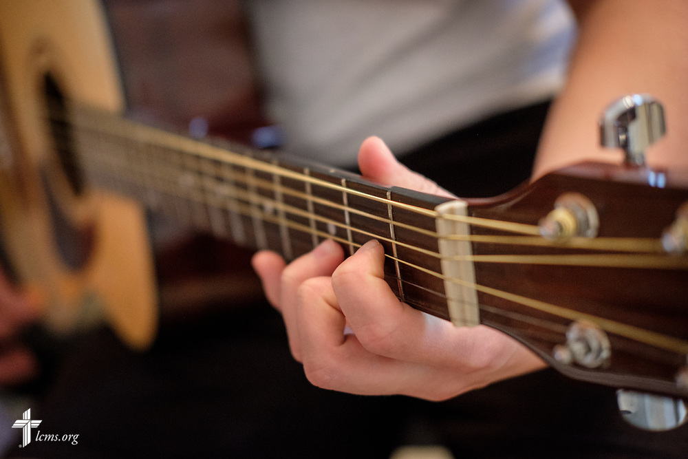 Young Adult Corps participant Paul Mroczenski practices guitar for an upcoming performance on Tuesday, April 3, 2018, at Camp Restore in Baton Rouge, La. LCMS Communications/Erik M. Lunsford