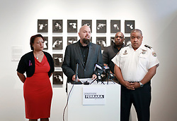02 October 2014. Jonathan Ferrara Gallery, New Orleans, Louisiana. <br /> 'Guns In The Hands Of Artists' show opening at the Jonathan Ferrara Gallery. Speakers included councilwoman Latoya Cantrell (in red), gallery owner Jonathan Ferrara and NOPD police chief Michael S. Harrison. The show brings together over 30 internationally acclaimed artists who took parts from 190 destroyed weapons acquired by the New Orleans Police department  and converted them into art.  <br /> Photo; Charlie Varley/varleypix.com