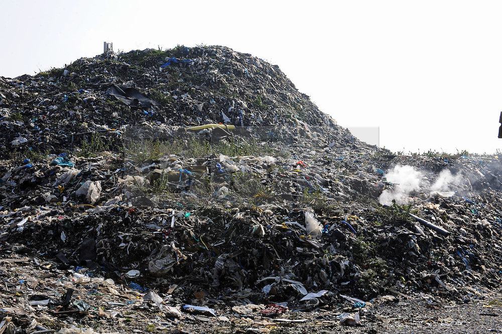 © Licensed to London News Pictures. 11/03/2016<br /> Abandoned rubbish mountain (Waste4fuel site) on fire again this afternoon.<br /> The Waste4fuel site in St Pauls Cray,Orpington,Kent continues to be an eyesore and a blight to the local community. Legal issues are holding up the removal of the rubbish from the site.<br /> <br />  (Byline:Grant Falvey/LNP)