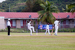 Umpire Peter Nero (left) watches Leeward Islands Hurricanes fast-medium bowler Jeremiah Louis (2nd from left) bowl on the final day of the seventh round match in the WICB Professional Cricket League Regional 4-Day Tournament against Leeward Islands Hurricanes at Addelita Cancryn Junior High School. Also pictured are: fielder Daron Cruickshank (3rd from left) and non-striking batsman Kevin McClean (right).  22 February 2016.  St. Thomas, VI.  © Aisha-Zakiya Boyd
