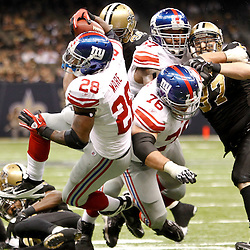 November 28, 2011; New Orleans, LA, USA; New York Giants running back D.J. Ware (28) runs against the New Orleans Saints during the fourth quarter of a game at the Mercedes-Benz Superdome. The Saints defeated the Giants 49-24. Mandatory Credit: Derick E. Hingle-US PRESSWIRE