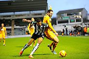 Plymouth Argyle's Jake Jervis and Cambridge Utd's Greg Taylor battle for the ball during the Sky Bet League 2 match between Plymouth Argyle and Cambridge United at Home Park, Plymouth, England on 12 December 2015. Photo by Graham Hunt.