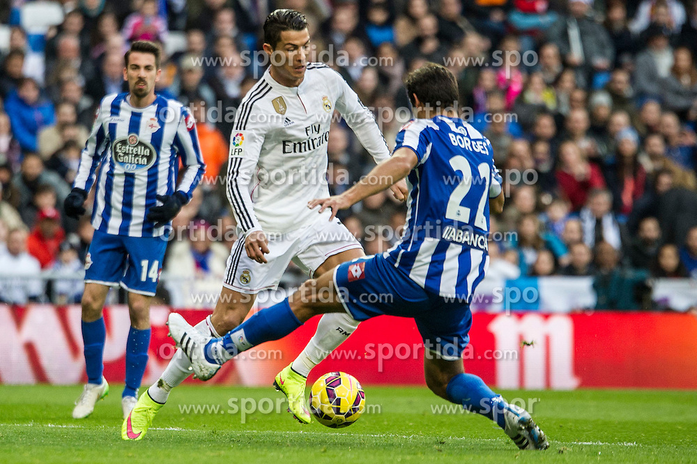 14.02.2015, Estadio Santiago Bernabeu, Madrid, ESP, Primera Division, Real Madrid vs Deportivo La Coruna, 23. Runde, im Bild Real Madrid&acute;s Cristiano Ronaldo and Deportivo de la Coruna's Celso Borges // during the Spanish Primera Division 23rd round match between Real Madrid vs Deportivo La Coruna at the Estadio Santiago Bernabeu in Madrid, Spain on 2015/02/14. EXPA Pictures &copy; 2015, PhotoCredit: EXPA/ Alterphotos/ Luis Fernandez<br /> <br /> *****ATTENTION - OUT of ESP, SUI*****