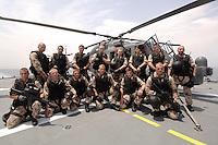 """25 SEP 2006, GOLF VON TADJURA/DJIBOUTI:<br /> Soldaten der Spezialisierten Einsatzkraefte Marine, ausgeruestet fuer """"Fast Roping"""" - das abseilen auf ein fremdes Schiffes zur Ueberpruefung - posieren fuer ein Gruppenfoto vor einem Hubschrauber Typ Sea Lynx auf der Fregatte """"Schleswig-Holstein"""". Die Fregatte ist als Flaggschiff Teil des deutschen Marinekontingents der OPERATION ENDURING FREEDOM und operiert im Seegebiet am Horn von Afrika<br /> IMAGE: 20060925-01-069<br /> KEYWORDS: Dschibuti, Bundeswehr, Marine, Soldat, Soldaten, Afrika, Africa"""