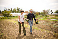 "DAVIS - APRIL 15: Husband and wife team, Pamela Ronald, a plant geneticist, and Raoul Adamchak, a bio-gardener, walk through the garden at UC Davis, in Davis, Ca., on Friday, April 15, 2011. The couple co-authored ""Tomorrow's Table: Organic Farming, Genetic and the Future of Food."""
