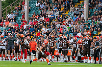 KELOWNA, BC - AUGUST 17:  Brycen Mayoh #4 misses a catch as Nathan Falito #1 of Westshore Rebels looks to recover the ball as Nate Adams #41 of Okanagan Sun catches the interception in front of the Okanagan Sun team bench at the Apple Bowl on August 17, 2019 in Kelowna, Canada. (Photo by Marissa Baecker/Shoot the Breeze)