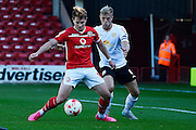 Crewe Alexandra defender Harry Davis holds up Walsall striker Tom Bradshaw during the Sky Bet League 1 match between Walsall and Crewe Alexandra at the Banks's Stadium, Walsall, England on 26 September 2015. Photo by Alan Franklin.