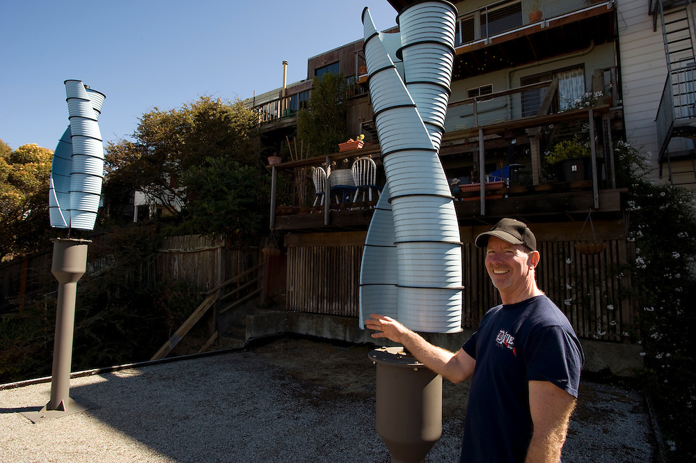 Chris  Beaudoin on the roof of his home in San Francisco. His two wind power turbines will create about 30 % of the needed energy for his household..Alternative Energy in Silicon Valley and the San Francisco Bay Area