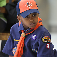 Phernando Wade, 7, of the Tiger Den pack 3 watches as his car races during Saturday's district level Pinewood Derby held at the Mall at Barnes Crossing food court.  Winners of today will advance to the Yocona Area Council Pinewood Derby at the Tupelo Auto Museum next month