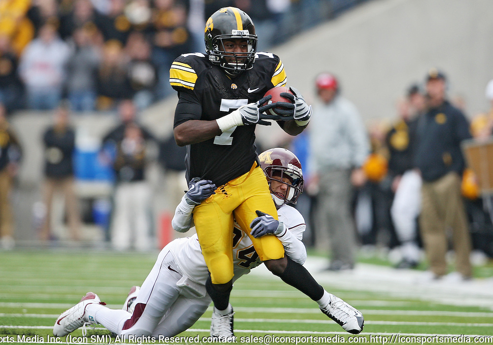November 21, 2009: Iowa wide receiver Marvin McNutt (7) is hit by Minnesota cornerback Marcus Sherels (24) during the second half of the Iowa Hawkeyes 12-0 win over the Minnesota Golden Gophers at Kinnick Stadium in Iowa City, Iowa on November 21, 2009.