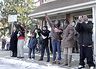 Terri Cummings, from Dayton (in the Browns jacket) waves as Hillary Clinton leaves the Fair River Oaks Council (FROC) office in Dayton after a campaign stop, Thursday, February 14, 2008. Mike Cummings from Dayton (right) holds two cell phones to take pictures of the motorcade as it goes by.