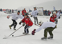 Of Mice and Men and the Ivy Lane Gang teams battle it out on Rink One during the first day of tournament play at the New England Pond Hockey Classic on Meredith Bay.  (Karen Bobotas/for the Laconia Daily Sun)