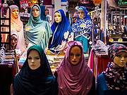 13 DECEMBER 2018 - SINGAPORE:  Muslim head scarves for sale in a shop in the Joo Chiat complex. Joo Chiat is a multi-tower high rise residential estate. There are hawker food stalls and retail businesses on the ground floor and residences on the upper levels.  The Geylang area of Singapore, between the Central Business District and Changi Airport, was originally coconut plantations and Malay villages. During Singapore's boom the coconut plantations and other farms were pushed out and now the area is a working class community of Malay, Indian and Chinese people. In the 2000s, developers started gentrifying Geylang and new housing estate developments were built.      PHOTO BY JACK KURTZ