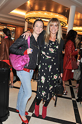 Left to right, LEAH WOOD and JO WOOD at a lunch to launch Cash & Rocket on Tour 2013 hosted by Julia Brangstrup in aid of Orpan Aid and Shine on Sierrra Leone held at Banca, 40 North Audley Street, London on 29th April 2013.