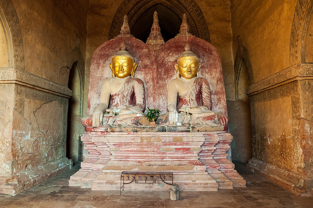 Buddha images at Dhammayangyi Pahto in Bagan, Myanmar. The date and builder of the Dhammayangyi Pahto are matters of some scholarly controversy, but it is generally thought to have been built by King Narathu (r. c.1167-70).